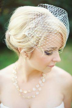 Vintage-styled birdcage veil: http://www.stylemepretty.com/2015/06/28/vintage-inspired-wedding-details-we-love/