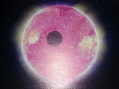 earth 's sun shooting off solar  flares seen through a pink filter. Reminds me of hot pink sapphire.