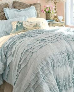Powder blue ruffled shabby chic bed sheets.  too girly for me?