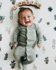 5 month cutie!  @beckaphall  shop Seafoam Footed Rompers & Prickle Pot Muslin at spearmintLOVE.com