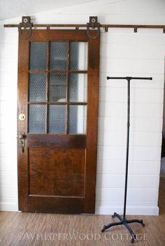 This would make such a cool pantry door in a kitchen or a mud room/ laundry room door. Like the idea of rolling doors like this instead of pocket doors. Old Doors, Sliding Doors, Entry Doors, Old Wooden Doors, Laundry Room Doors, Closet Doors, Bathroom Doors, Barn Door Hardware, Door Hinges