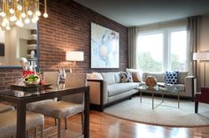 exposed brick living rooms | Exposed brick wall with contrasting artwork as a focal point