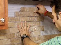 installing a backsplash for the kitchen :: Image via Architectural Art Tile