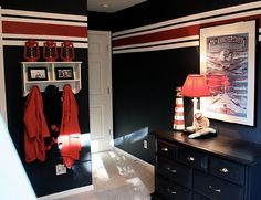 Gage's new walls are A LOT like this (red and white stripes) except he won't have black walls at the new house. He has them at the old house but decided he wanted grey at the new house.