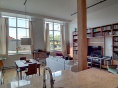 My condo at the Biscuiterie Viau, 2010-2011. A former cookie bakery converted to loft-style condos in 2007. We redecorated / renovated with tall bookshelves, white-painted brick, expanded kitchen cabinets with granite counters.