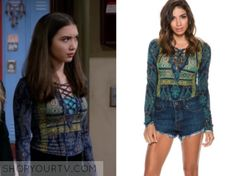 Riley Matthews (Rowan Blanchard) wears this blue and green lace up paisley printed top in this episode of Girl Meets World. It [...]