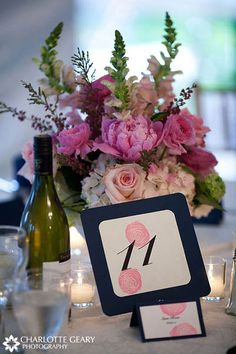 Flower girl in light pink dress with rose Wedding reception table number in