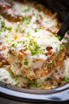 You'll make this slow cooker lasagna again and again! So saucy and cheesy! An easy make-ahead crockpot lasagna - the noodles cook right in the crockpot! | natashaskitchen.com