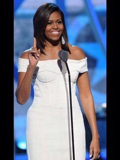 "Alright...That is the limit. The First ""Lady"" of the United States at 50 years of age in a flipping CORSET TOP DRESS and off the shoulder. The kicker? She wore this to an event called ""Black Girls Rock"". Way to be a wholesome role model, you hooch!"