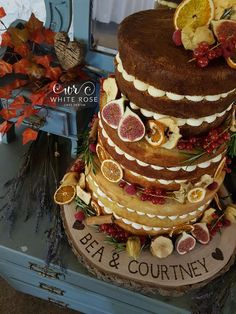 Autumnal Wedding Cake Naked Wedding Cake with Fruits for Autumn Wedding at East Riddlesden Hall by White Rose Cake Design West Yorkshire Cake Supplier