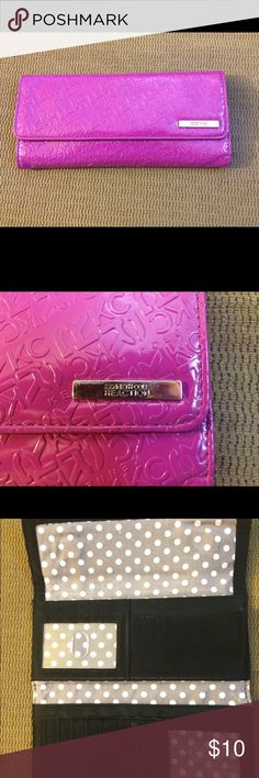 Kenneth Cole Reaction Pink wallet This wallet is in amazing condition with front magnetic closures, a zipper back for change and lots of room for cash, checks and cards. Has a slight spot on zipper back where original price sticker was shown in pic 4. Kenneth Cole Reaction Bags Wallets