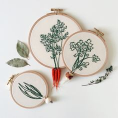 A set of three hand embroidered hoops featured with felt celery, carrots, and onion The diameter of hoops are around 4.9(12.5cm), 6.1(15.5cm),...