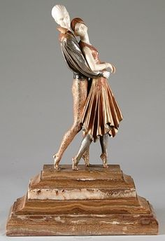 Dimitri Chiparus. bronze and ivory sculpture depicting a pair of ballet dancers in elaborately decorated cold  The back of the base is marked Etling Paris and D. H. Chiparus.