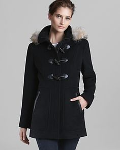 Love this coat in white with the contrasting black toggles and pocket trim!