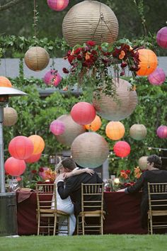 copper colored wedding reception | Hand-painted lanterns and a hanging arrangement that takes nature one ...