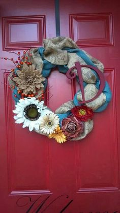 Burlap wreath with flowers and initial for the front door.