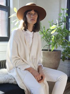 Fedora and whites and creams | The Lifestyle Edit