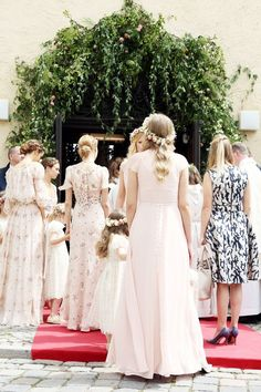 Inside a Fairy-Tale Royal Summer Wedding in Bavaria - The bridal party wore blush pink gowns with embroidered floral details.
