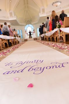 """To infinity and beyond"" custom aisle runner at Disney's Wedding Pavilion"