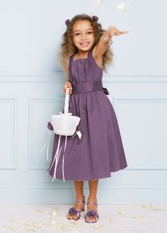 Tank strap cotton sateen dress with self tie bow in back, t-length skirt.   Cotton sateen dress with self tie bow in back.  Sizes 2T-8 are available.