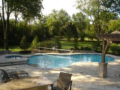 check out this #freeform design featuring a pool volleyball net #swimmingpool #pools #BarringtonPools