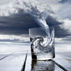 very cool photoshopping: storm cloud sucked into glass returns to its natural form: water –or it could be in reverse ; )  suction animation reminds you of MacOSX Dock Genie effect