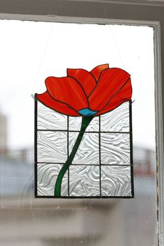A poppy in the stained glass panel would be great