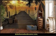 Evoking the enchantment of pirate adventures, this tropical wall mural adds a stunning scene to a room. A weathered dock stretches out into the sea at sunset, while a ship sails away beyond palm trees.