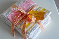 These Ribbon Dish Towels would be so easy to make as gifts - maybe for a bridal shower?