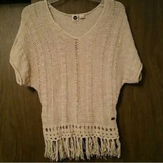 Roxy shirt Cute Roxy shirt worn once , perfect condition , fringe detail , looks cute with jeans or as a beach coverup  Roxy Tops