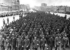 """300,000 German prisoners were taken in the operation. The Allies did not believe the numbers, and Stalin ordered to march the captive Germans through Moscow. Photo: German soldiers captured during operation """"Bagration"""" walking in Moscow. The Russian crowd mocked: """"You finally made it to Moscow!"""". September, 1944."""