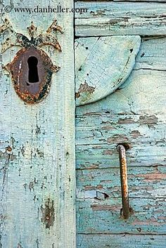 great shade of blue vintage door with keyhole