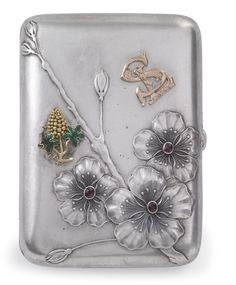 A Fabergé Silver Cigarette Case, Moscow, circa 1900, rectangular with rounded corners, the hinged cover chased and repoussé with gem-set flowers, also applied with a gold monogram and gold grape cluster with enameled leaves.