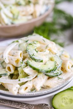 Creamy Cucumber Pasta Salad! This summery pasta salad combines our favorite cucumber salad with fresh dill and pasta for the perfect potluck side dish!! Add a squeeze of lemon or a handful of cherry tomatoes for a great twist!