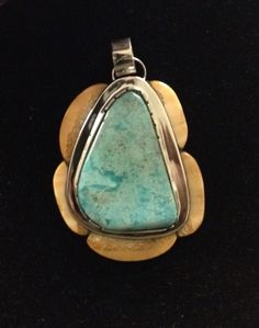 Burtis Blue turquoise surrounded by fossil Walrus Tusk pendant by Colorado Jewelrydude.