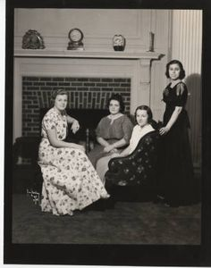 Black and white photograph depicting three students in a seated pose and one standing posed for photographer Eric Stahlberg in dormitory living room, This photograph is part of a donation given by class member Grace Nelson Paulsen. Dormitory, Still Image, Digital Image, Archive, Students, Poses, Living Room, Black And White, Collections