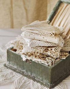 Box of crocheted doilies. But my mother's doilies were never put away like this. They were all starched and ruffled!
