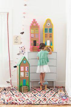 Learn how to make beautiful cardboard houses in the book Playful by Merrilee Liddard