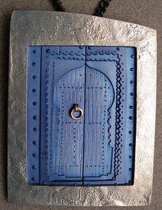 "Pendant | David Rennie Cruickshank ""Moroccan Door, Chefchaouen"".   Silver and Titanium"
