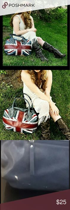 Charming Charlie Union Jack bag Scuff happened in store ive took great care of the purse otherwise the scuff is on the backside so it won't be seen often. I got hella compliments on this bag so it's worth its little flaw! Charming Charlie Bags Shoulder Bags