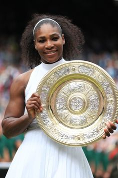 Serena Williams Photos - Serena Williams of The United States lifts the trophy following victory in The Ladies Singles Final against Angelique Kerber of Germany on day twelve of the Wimbledon Lawn Tennis Championships at the All England Lawn Tennis and Croquet Club on July 9, 2016 in London, England. - Day Twelve: The Championships - Wimbledon 2016