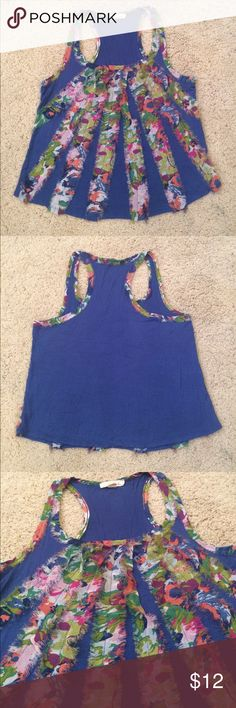 Lush Tank Top Frilly and Colorful Frayed Abstract Lush brand tank top in size XS. Bright blue accented with multi colored Frayed sheer strips, super bright and bold. Rayon and polyester. In gently used condition. With no stains or rips. Measurements- CHEST: 16.5 in. LENGTH: 20 in. SHOULDERS: 10.5 in. If you have any questions please don't hesitate to ask! Lush Tops Tank Tops