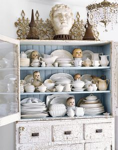 why would you have baby doll heads sticking out of cups in your kitchen, JUST WONDERING????