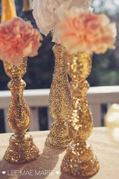buy cheap wooden candle sticks from the craft store and cover them in glitter! I think I'm liking the gold...