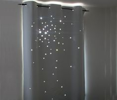 Star curtain with a cut-out pattern of 60 stars inspired by real celestial cluster