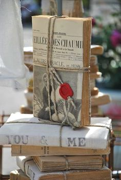 cover a book with newsprint - tie with twine - use sealing wax on the twine ends