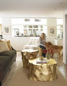 Gold tree stumps as coffee tables
