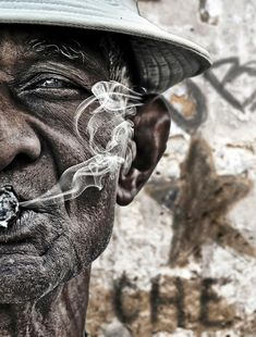 ♂ Old man's face smoking portrait