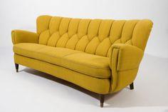 thegallivantinggirl:  Sexy couch from Danish Teak Classics.