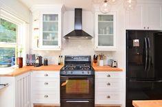 not a fan of glass cabinets beside cooktop, and corner display shelf useless, prefer proper bookshelf for cookbooks